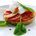 Poached egg on wholemeal bagel with tomato & spinach