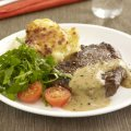 Steak with brandy & peppercorn sauce