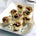 Beef, olive & red onion canapés