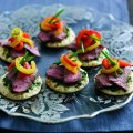 Lamb blinis with marinated peppers & herb relish