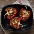 Stuffed red peppers with garden vegetables