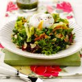 Summer leafy salad with salsa verde dressing