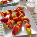 Fruit kebabs with strawberry milk