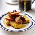 Pain perdu with caramelised apple wedges, plums & walnuts