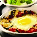 Baked eggs with courgette & tomatoes
