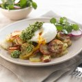 Pommes Anna with eggs, rocket & walnut pesto