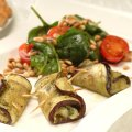 Aubergine, pesto & mozzarella rolls with spinach & pinenut salad