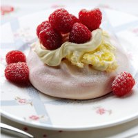 Rosewater mini pavlova filled with clotted cream & raspberries