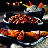 Mexican chilli bowl with crispy jacket wedges